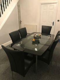 Glass Dining Room Table with 6 black chairs - Immaculate condition