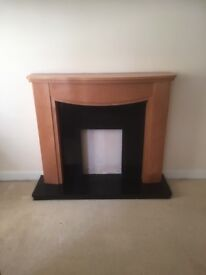 Teak fire surround with black marble insert and hearth, with optional electric fire.