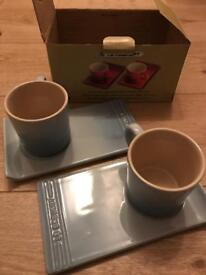 Le Creuset set of 2 cappuccino mugs and trays in costal blue
