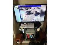PS 4 +TV+GLASS STAND BLACK+SONY SPEAKERS+3 GAMES