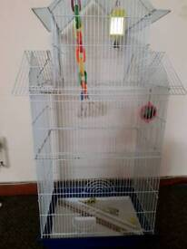 Large bird cage with food, toys