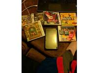 3DS XL new kind Boxed, charger + 8 games