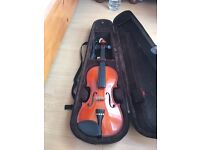 Violin with shoulder pad, resin and lock
