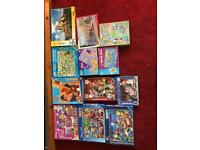 9 children's and 3 adults jigsaw puzzles