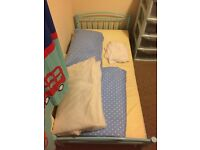 Toddler bed with mattress and bedding
