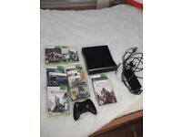 X box 360 with games for sale.