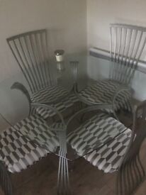 Glass table and four chairs for sale £90