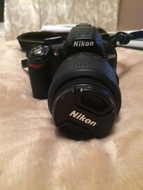 Nikon D3100 camera with case and 8GB memory card