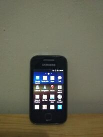 Samsung Galaxy Y-GTS compact sized with accessories