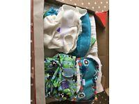 Big bundle of reusable cloth nappies, covers & liners
