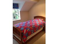 Cherry wood single bed with additional single beneath