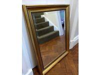 Very stylish beveled edge gold mirror