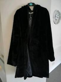 Ladies black fur Cape coat.