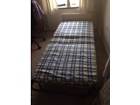 Single fold out guest bed with mattress