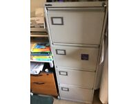 Grey 4 drawer filing cabinet with key