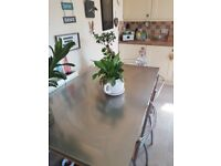 Large solid kitchen table and 4 chairs