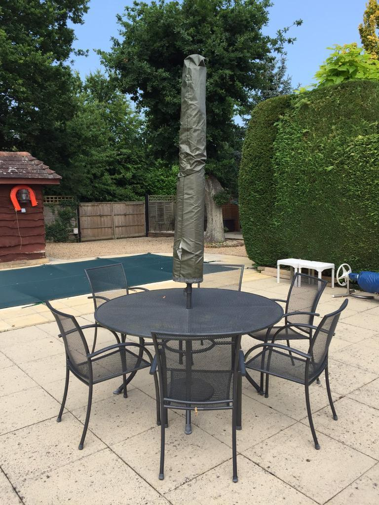Six seater metal outdoor table set with umbrella