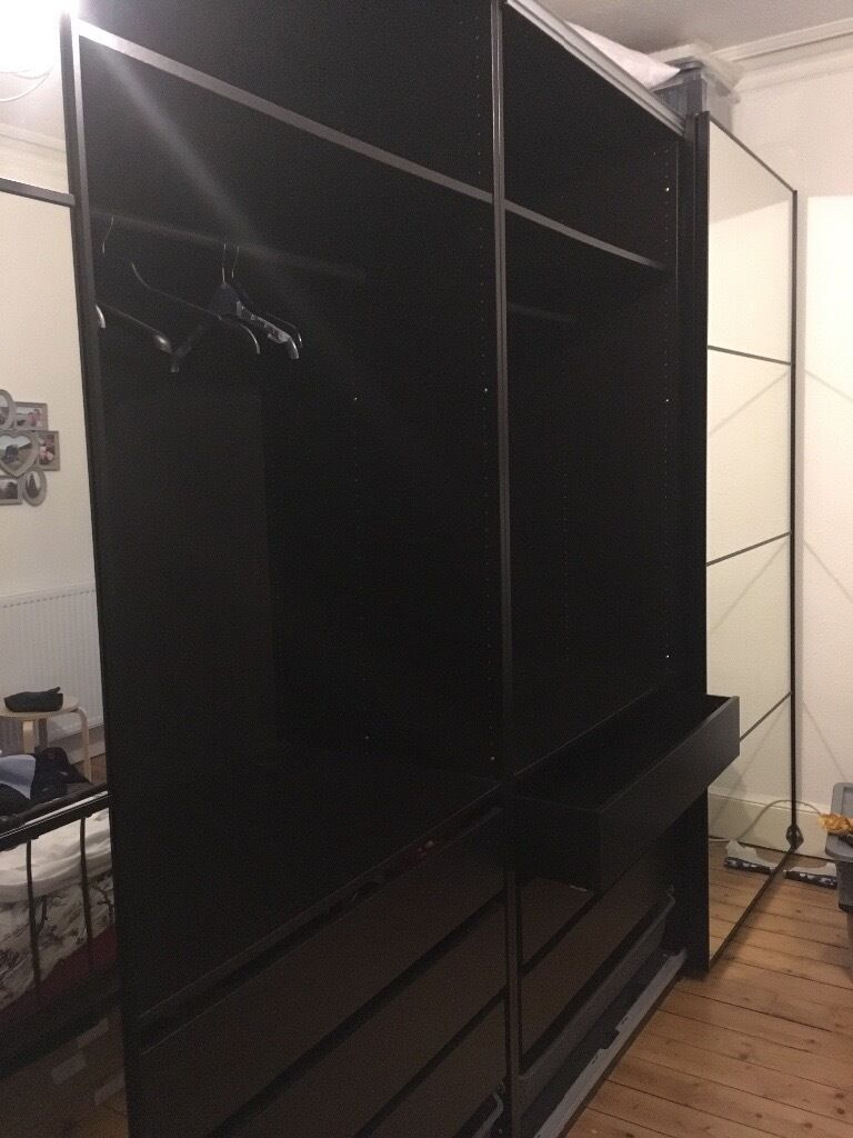 large ikea pax wardrobe s with sliding mirrored doors in. Black Bedroom Furniture Sets. Home Design Ideas