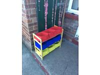 Child's cloth storage boxes and toybox.
