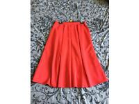 Red pleated swing midi skirt
