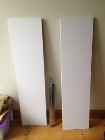 two white shelves