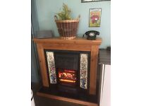 Fire and Fireplace. Period style electric fire with pine surround.