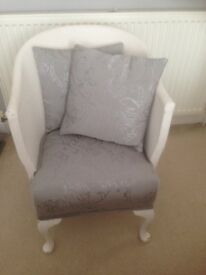 Bedroom wicker chair with grey cover and matching cushions .