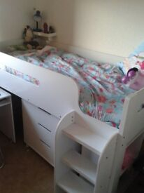 Single bunk bed set with desk, drawers, and shelves