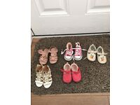 Various toddler shoes for sale.