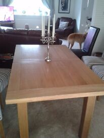 dining room table in light oak. Modern design seats 6 extends to seat 8. Excellent condition.