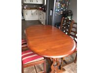 Lovely solid dark wood dining table with 4 chairs
