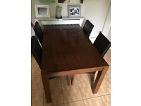 Solid wood dining table with 6 leather and wood chairs
