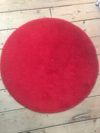 3 round ikea red rugs