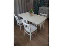 Lovely solid drop leaf dining table with 4 chairs