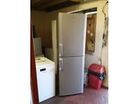beko 6 foot tall and 2 foot wide frost free half and half silver fridge freezer