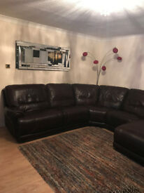 Large, dark brown Italian leather recliner corner sofa.