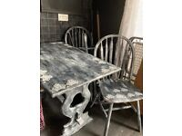 Pine table and 4 chairs painted in gothic chic but can be stripped again!