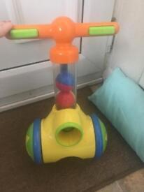 Tiny push along ball popper