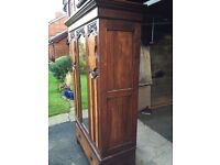 Antique beautifully carved mahogany wardrobe with veneer panels, full length mirrored door & drawer
