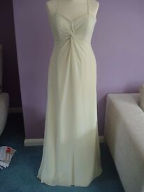 Two matching pale yellow bridesmaid/occasion dresses size 12 & 14
