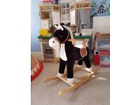 Rocking horse with sounds and music