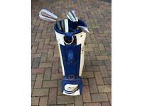 Old golf bag and a few clubs.