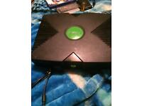 For sale a original Xbox plus games