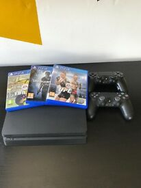 PlayStation 4 slim 1tb, 2 controllers and games comes with box.
