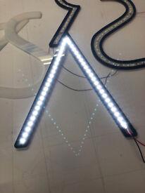 Halo illuminated shop signs