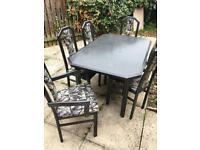 Black and grey table and 6 chairs for a kitchen