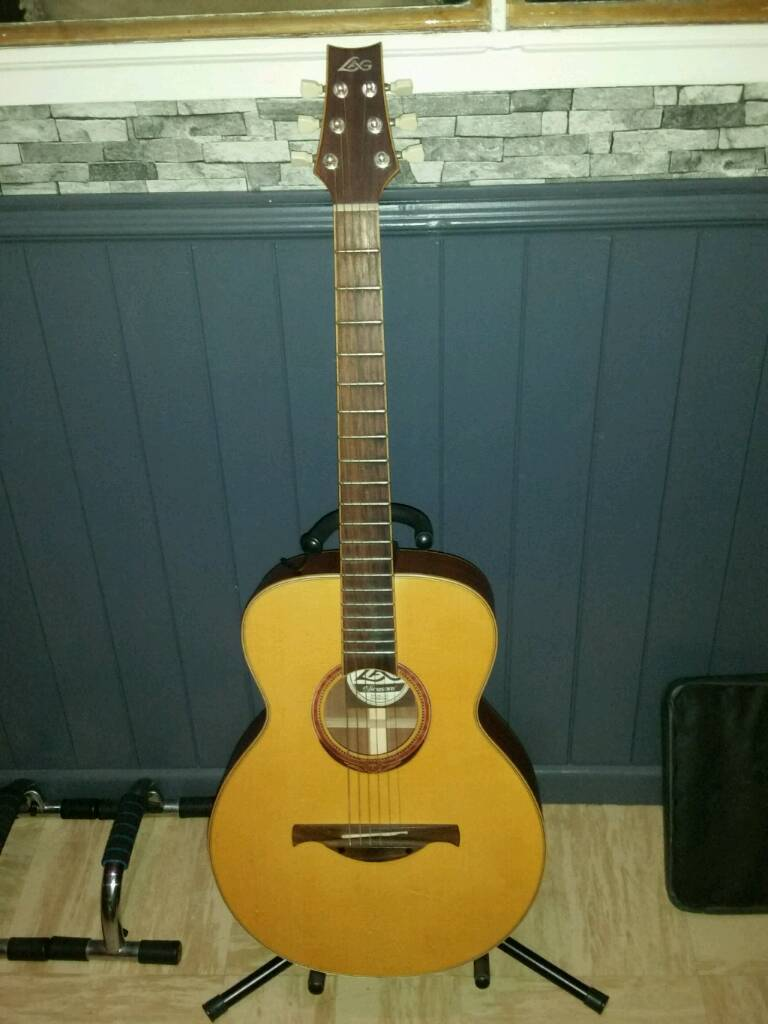 Lag acoustic guitar with stand,capo and tuner