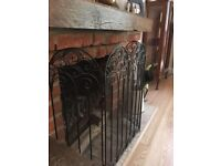Wrought iron fire guard Black very decorative. Opens on both sides.