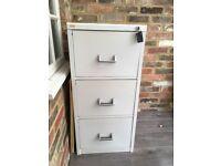Metal 3 drawer filing cabinet. Lockable. For hanging files.