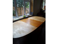 Large wooden expanding dining table